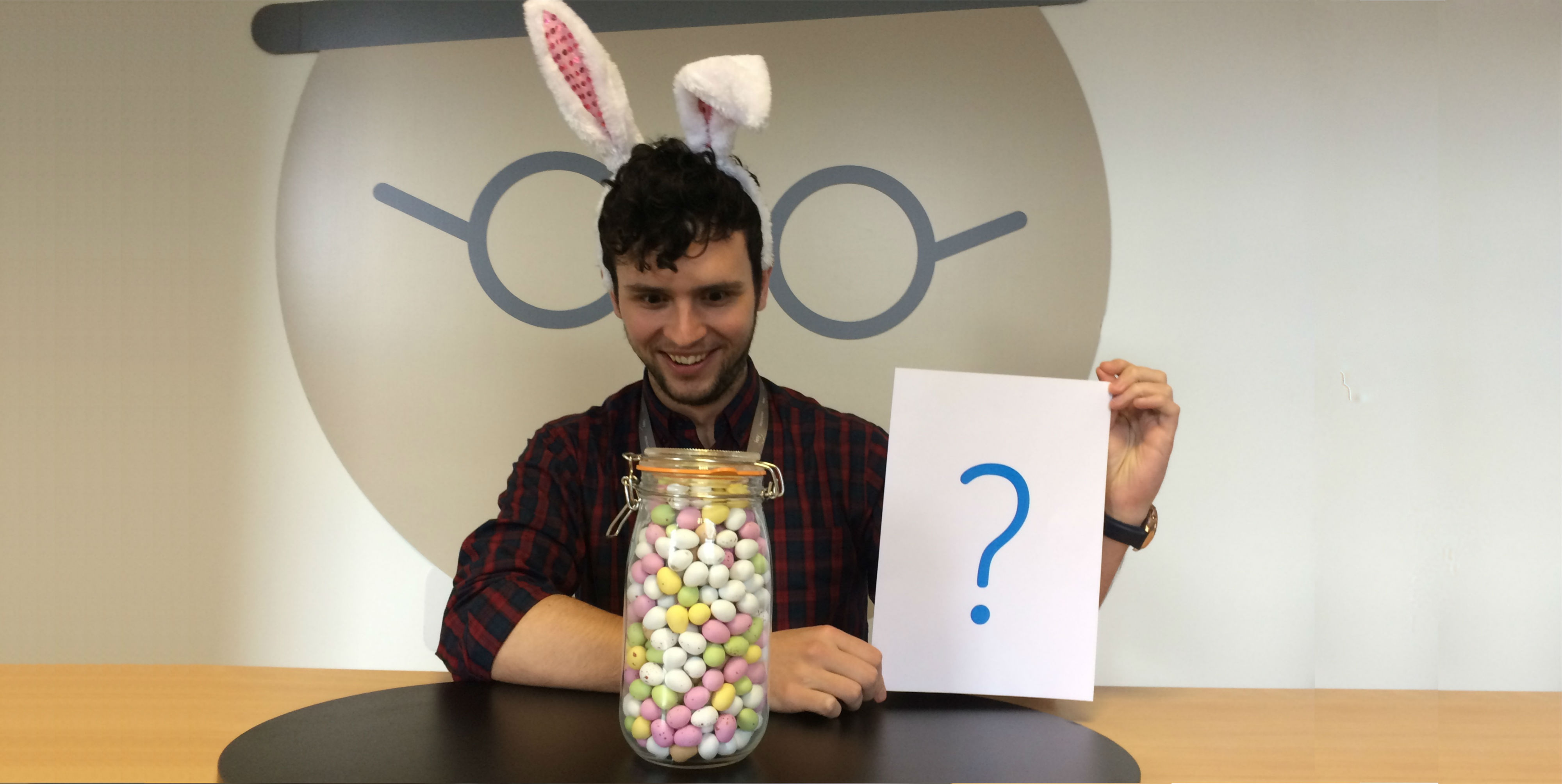 Easter bunny with jar of eggs