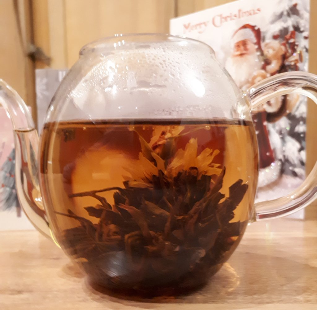 A-bloom black tea in glass teapot