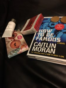 A signed book, chocolate coins and shells, hand cream and two eye masks.