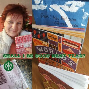 Clockwise from top left; Irina with her wrapped gift, gift bag, World's best spicy food book, patterned notebook, postage label.
